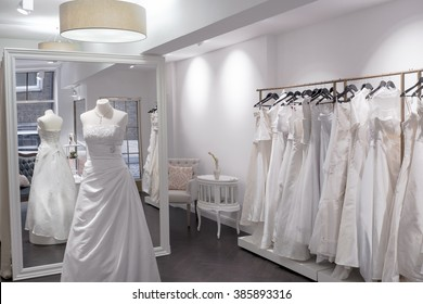 Bridal shop, boutique wedding dress store, mannequin and large mirror, Beautiful Wedding Gowns