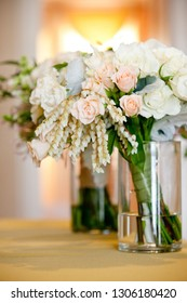 bridal wedding bouquet in a glass jar before the wedding ceremony, White and pink flowers
