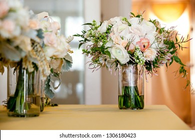 a bridal wedding bouquet in a glass jar before the wedding ceremony, White and pink flowers set down on a table