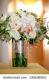 a bridal wedding bouquet in a glass jar before the wedding ceremony, White and pink flowers