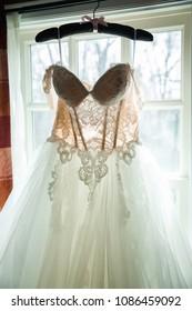 bridal wedding dress  in a hotel room