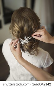 Bridal wedding hairstyle with jewelry. Elegant hair accessorie.