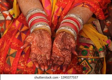 Bridal wedding henna, mendhi. Red bridal bangles. Colourful attire.