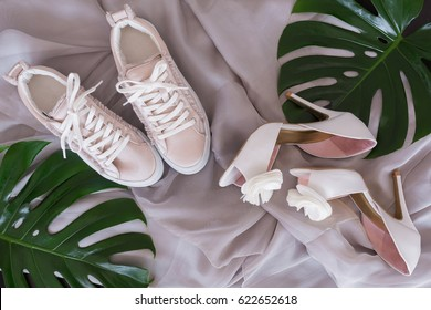 Bridal wedding shoes and sneakers, Accessories, invitations and flowers for the ceremony on the table