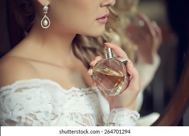 bride applying perfume