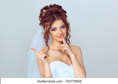 Bride asking for silence and attention. Closeup portrait serious upset woman finger, hand on lips, shhh gesture asking be quiet isolated on light blue background. Negative face expression sign emotion