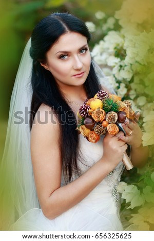308d99dfcae3 Bride attractive girl female portrait with long black hair in white dress  and beautiful veiling with artificial bridal bunch. Pink, white, red,  orange ...