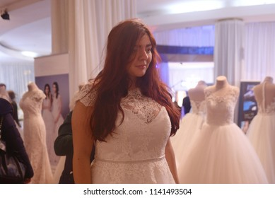 Bride to be trying on wedding dresses