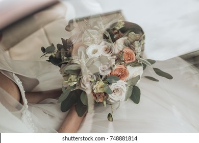 bride with beautiful charming wedding bouquet with white and pink flowers