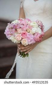 Bride with beautiful wedding bouquet, closeup