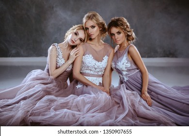 Bride blonde young women in a modern color wedding dress with elegant hair style and make up. Fashion beauty portrait composition over textured background