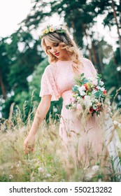 Bride With Bouque And Tiara On Nature Background
