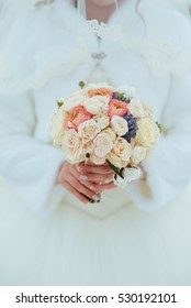bride with a bouquet on the winter background