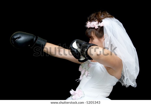 The bride the boxer puts impact on a black background