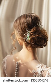 Bride. Bridal wedding hairstyle with jewelry. Elegant hair accessorie.