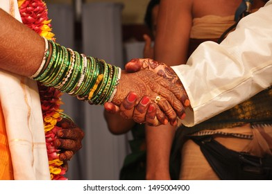 Bride and bridegroom doing promises in marriage as per Indian hindu traditional