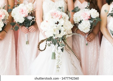 bride and bridesmaid holding white and pink flower bouquets, close up, modern wedding, pink dresses, peony and poppy flower