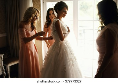 Bride and bridesmaids during the wedding preparations