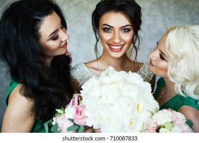 Bride and bridesmaids have fun posing in the room