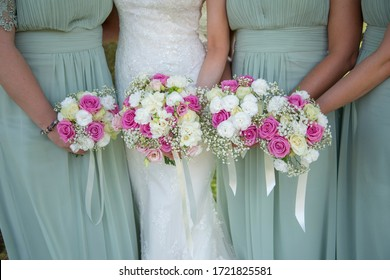 Bride and Bridesmaids holding floral bouquets