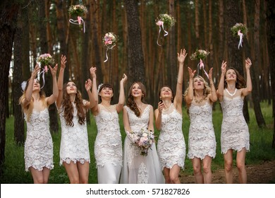Bride and bridesmaids throwing wedding bouquets