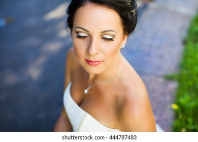 Bride brunette with hairstyle and wedding make-up, portrait