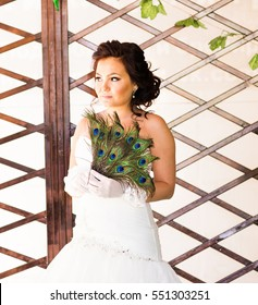 Bride  close up with  fan made of peacock feather