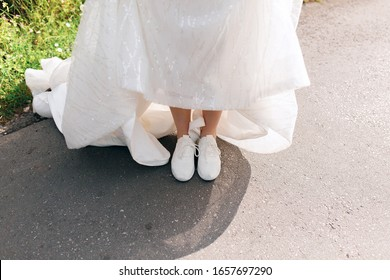 bride in comfortable sneakers white