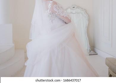 bride dancing in a bright room