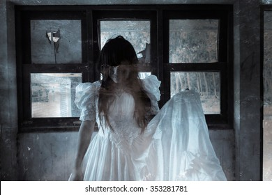 Bride of the Dead,Ghost in Haunted House,Mysterious Woman in White Dress Standing in Abandon Building,Horror Background For Halloween Concept and Book Cover Ideas