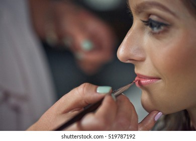 Bride is doing a makeup for the wedding