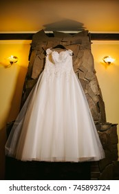 bride dress on wall background, in hotel