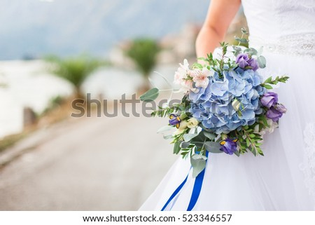 Bride dressed white wedding dress holding stock photo edit now the bride is dressed in white wedding dress and holding wedding bouquet of eucalyptus blue mightylinksfo