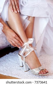 Bride dressing shoes. Leg of young woman in shoes.