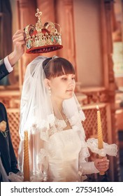 Bride during orthodox wedding ceremony with crown