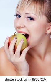 Bride eating apple on white background