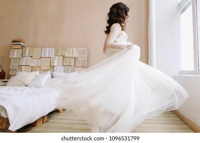Bride in elegant classic wedding dress. Morning of the bride. Wedding preparations.