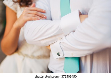 Bride embraces bridegroom