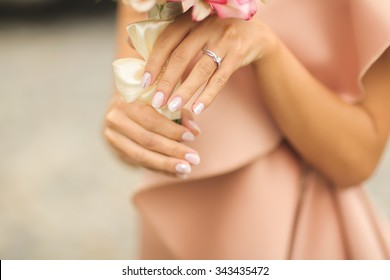 Bride with flower bouquet and engagement ring