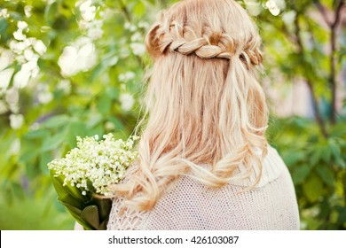 bride with flowers in the forest