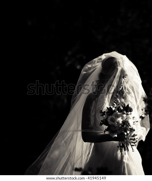 A bride getting ready to walk down the aisle.