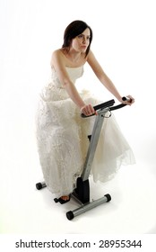 Bride getting in shape by working-out on a gym bike