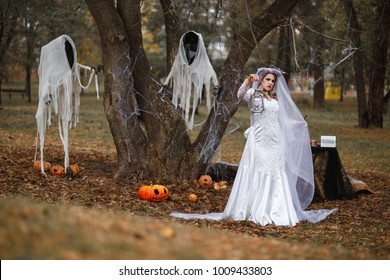 Bride Ghost walks in the forest  near two ghost, Halloween, Samhain