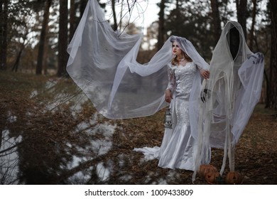 Bride Ghost walks in the forest  near two ghost with flashlight in herhands, Halloween, Samhain