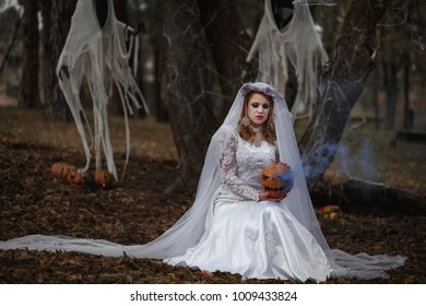 Bride Ghost walks in the forest  near two ghost with pumpkin in hands, Halloween, Samhain