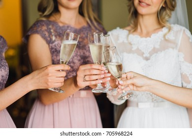 The bride and girlfriend drink champagne. Close-up