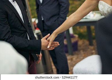 Bride is giving a hand to the groom
