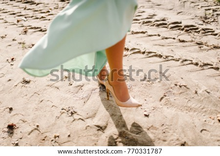 38133e4b8 ... Stock Photo (Edit Now) 770331787 - Shutterstock. The bride go on the  sand on the beach. Close up. View of the