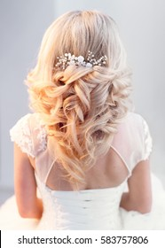 Bride in greek hair style. View of the hair.