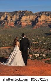 Bride and groom admiring sunset